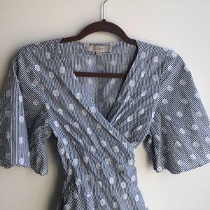 Light blue wrap tie blouse